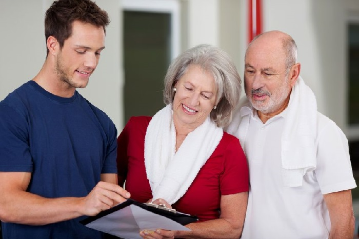 Physical Fitness Trainer with Senior Couple